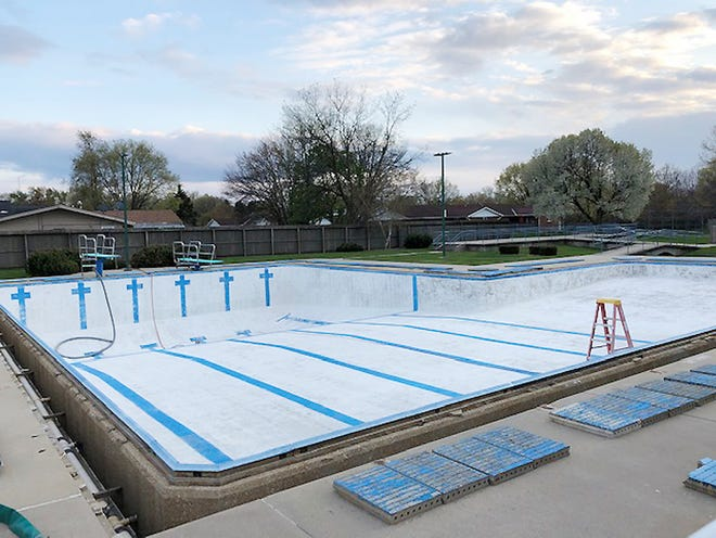 Painting is among the many preparations being made at Fairbury's Stafford Community Swimming Pool prior to its projected opening for the season during Memorial Day weekend.