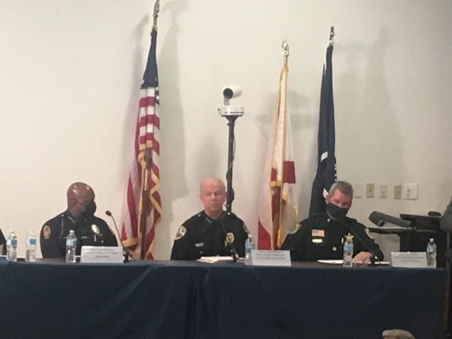 Palm Beach Gardens Police Chief Clinton Shannon, center, speaks during a forum on policing at the FAU campus in Jupiter.