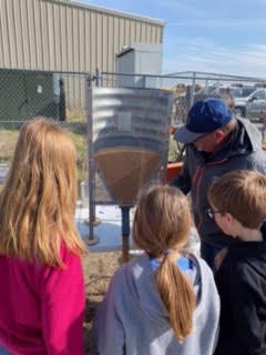 Charles Collins, Skyland Grain Safety Consultant, demonstrates how combustible grain dust is at last week's Kids Ag Day at Skyline High School west of Pratt.