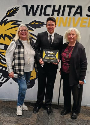Pratt High School student Colby Barradas (middle)celebrates his receipt of the Rudd Scholarship with his mother, Connie Clark (left) and his grandmother, Joan Clark (right). He will attend WSUthis fall.