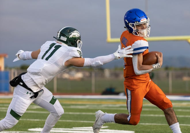 Kimball Jaguars quarterback Nicholas Coronada (6) runs the ball for a 10 yard gain during the second quarter in the game against Manteca High at Don Nicholson Stadium at Kimball High in Tracy Friday, March 19, 2021. Manteca won 44-38. [SARA NEVIS/FOR THE RECORD]