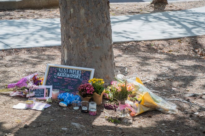 Mementos from a vigil for Kristin Smart outside Santa Lucia Hall on the Cal Poly campus near the last place she was seen alive in 1996.