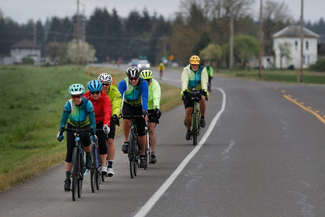 Bike riders from GEARs (Greater Eugene Area Riders) make their way north on Coburg Road during one of many weekly rides organized by the group.