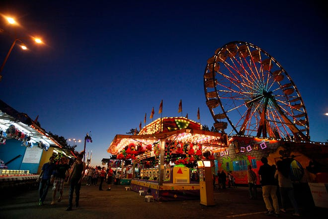 The Lane County Fair is lit up by carnival lights just after sunset in 2014.