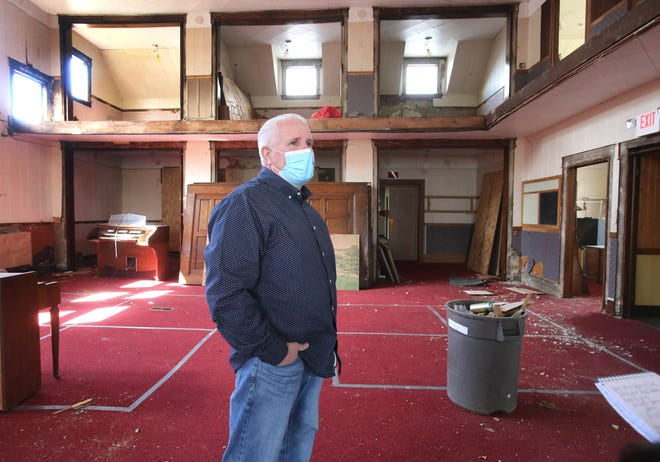 """Eugene Lingenhoel, founder and executive director of The Legacy Project of Stark, stands in the sanctuary of a former church on Tremont Street SW in Massillon. The nonprofit group bought the 121-year-old church in November and is transforming it into the """"708,"""" which will house space for programming and serve as the organization's headquarters."""