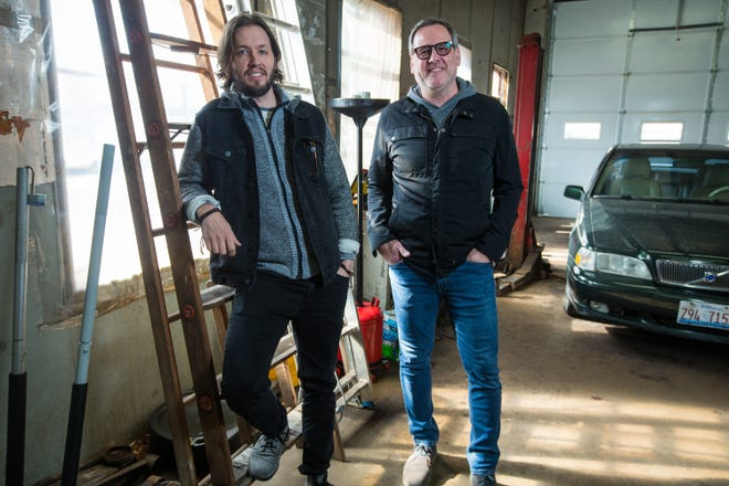 Writer and director Nick Snow, left, and producer Don Hatton, seen here on Wednesday, April 21, 2021, at Carl's Auto Repair in Rockford, filmed a scene from their new feature-length film at the automotive shop.