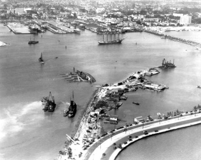 """Aerial view of the """"Prinz Valdemar"""" overturned in the ship channel on Jan. 10, 1996, in Miami. Miami's harbor was closed for more than a month while 100 ships with 45 million board feet of lumber and other building materials awaited unloading. The harbor closing in January and the hurricane in September ended Miami's boom."""