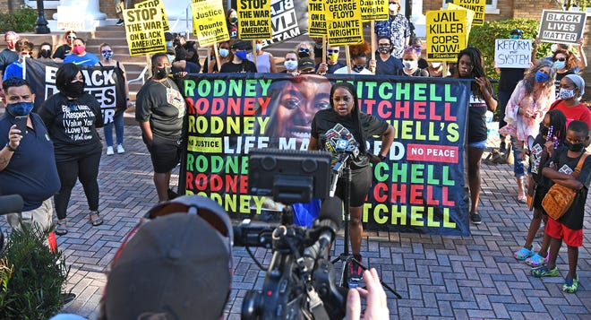 More than 40 people gather April 22 at a rally for justice on the steps of the Manatee County Courthouse, in Bradenton, hosted by Black Lives Matter Manasota Alliance and the Party for Socialism and Liberation.