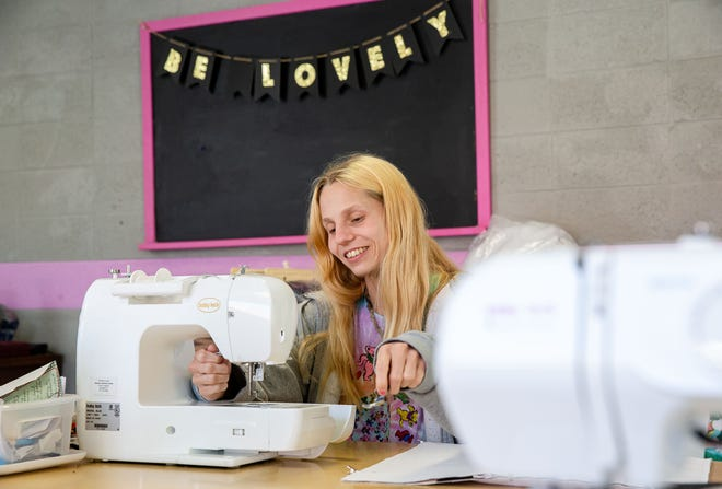 Alexis Meints prepares a sewing machine to create products for the Wooden It Be Lovely program at the Douglas Avenue United Methodist Church in Springfield, Ill., Thursday, April 15, 2021. Meints is one of four women that will be celebrated in a graduation ceremony for the Wooden It Be Lovely program, which provides women who are struggling with addiction or other serious issues employment to refurbish and sell donated wooden furniture and sew unique products. [Justin L. Fowler/The State Journal-Register]