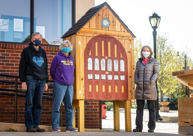 First Presbyterian Church parishioner Don Ecklund, left, along with Linda Justice, center, and Rev. Susan Phillips, right, with the new micropantry that mimics the historic red doors of the church on Capitol Avenue in Springfield, Thursday, April 22, 2021.