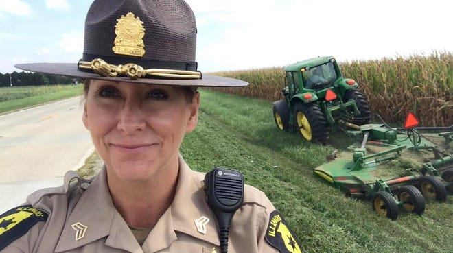 Illinois State Police Sgt. Tracy Lillard takes a selfie as her father mows along the roadside in rural Champaign-Urbana, to point out that drivers need to practice caution around tractors and slow-moving vehicles. Lillard tagged the Illinois Farm Bureau in a Facebook post, which received nearly 6,000 likes.