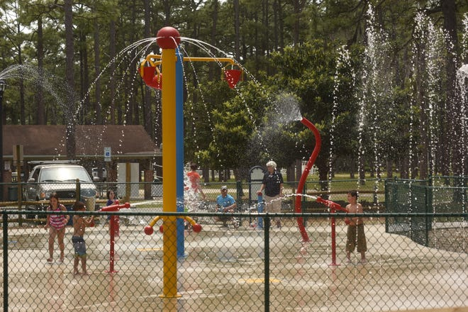 Kids play at the Hugh MacRae splash pad Friday, May 12 in Wilmington, N.C. In Pender County, officials from the Parks and Recreation Department are working on a comprehensive master plan, which includes an online survey asking residents where they would like to see facilities such as splash pads, trails, and dog parks, in the county. [KEN BLEVINS/STARNEWS]