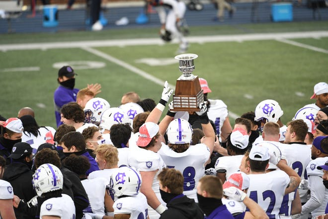 The Holy Cross football team celebrates winning the Patriot League title last week.