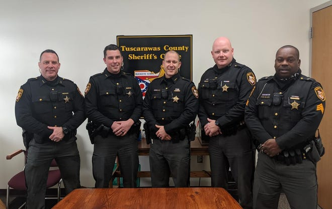 The staff of the Tuscarawas County Sheriff's Office includes (left to right) deputies Robert Shott, Michael Fink, Lincoln Troyer, Ben Watson and Sgt. Bruce Lowery.
