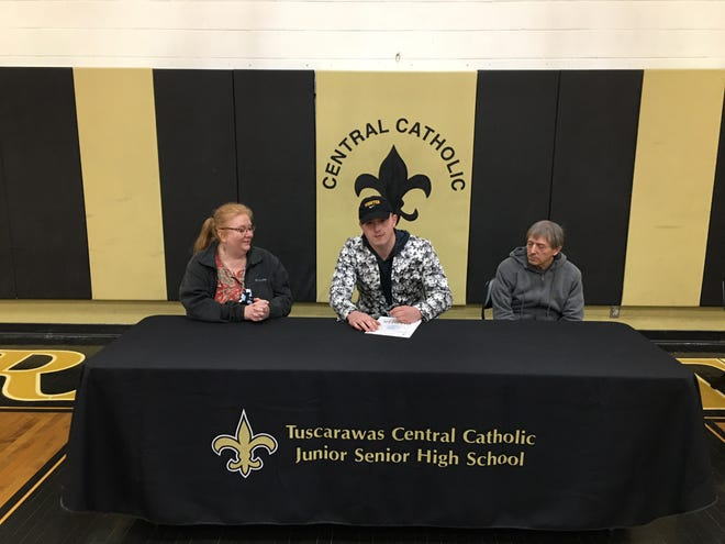 Tuscarawas Central Catholic senior Tobias Grossi signed a letter of Intent to attend the College of Wooster to play football and major in Education and History with a minor in Physical Education. Grossi is pictured with his parents Lisa Pauline Grossi and Bill Grossi at his signing Thursday.