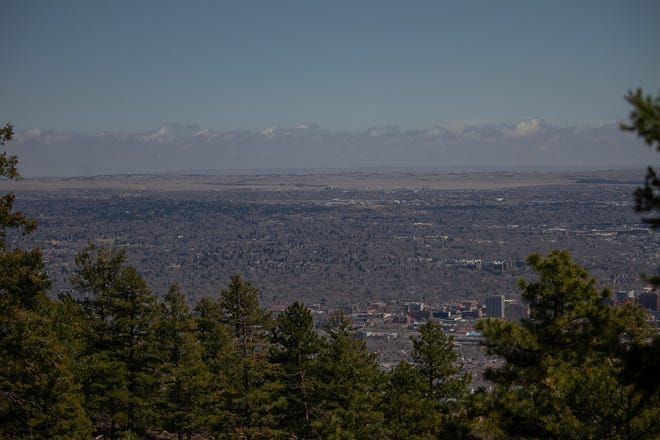 A wide view of Colorado Springs is afforded from Robbers Roost on Cheyenne Mountain.