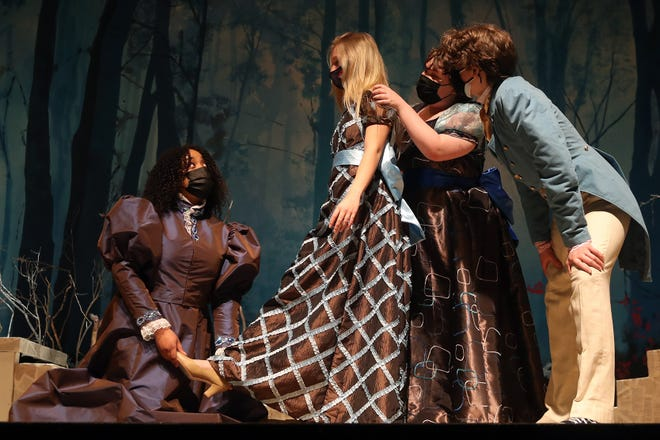 """From left, senior Sherie Stone as Stepmother, junior Elle Rollyson as Lucinda, senior Katie Krann as Florinda and junior Tyler Zwick as Cinderella's father perform a scene during a dress rehearsal for the Westerville South High School theater troupe's presentation of """"Into the Woods"""" on April 19. Showtimes are 7 p.m. May 7 and 9 and noon May 8 atthe school, 303 S. Otterbein Ave."""