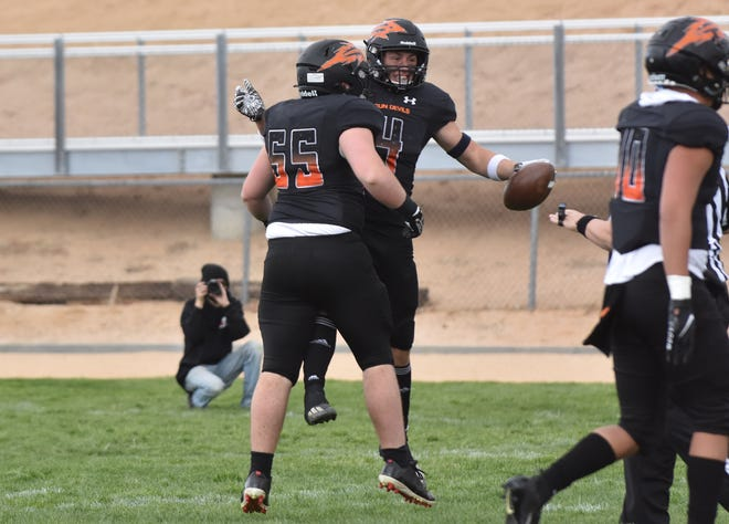 Apple Valley linebacker Dustin Reynolds, No. 4, celebrates with teammate Reed James after recovering a fumble against Serrano on March 20, 2021.