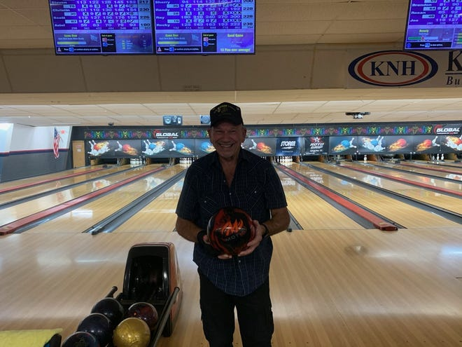 Mitchell smiles big after having a perfect bowling game.