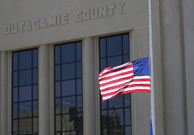 A U.S. flag flies at half-staff in front of the Outagamie County Government Center in Appleton. The flag was lowered in honor and remembrance of former Vice President Walter Mondale.
