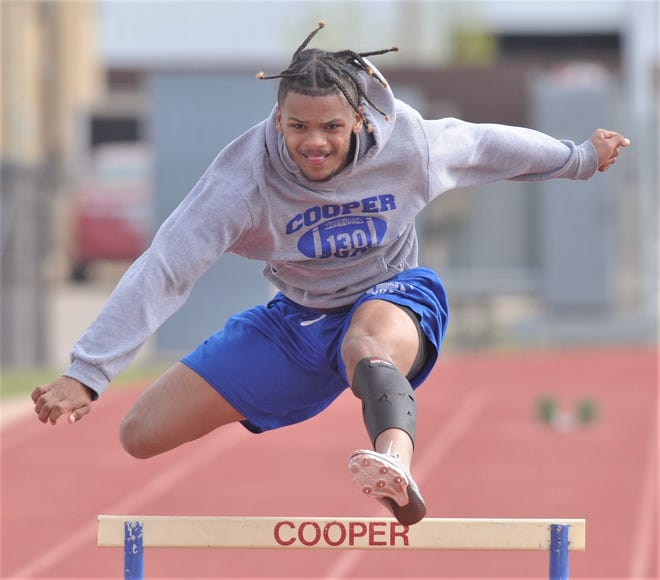 Cooper junior Lawrence Diles clears a hurdle during practice Tuesday at Cooper High School. Diles will compete in the 110- and 300-meter hurdles at the Region I-5A meet Friday in Lubbock.