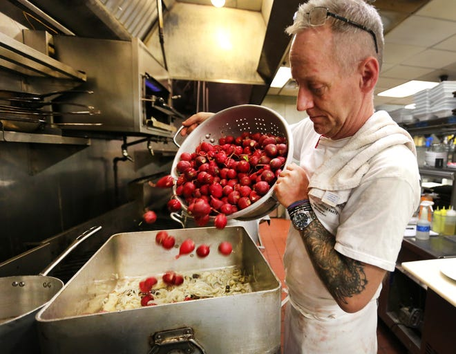 Jimmy Gibson, executive chef and co-owner of Jimmy G's in downtown Cincinnati is photographed in April of 2016. He volunteers to create soup for non-profit La Soupe twice monthly. He never knows what produce he'll receive, like when he got a large quanity of radishes. Though he'd never worked with so many radishes, he came up with a ginger, turnip, beef soup that people raved about. Suzy DeYoung, executive chef and owner of La Soupe, donates the soup to food-insecure families.