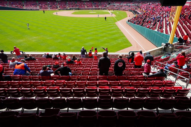 Fans enjoy the game during the seventh inning of a baseball game between the Arizona Diamondbacks and the Cincinnati Reds, Thursday, April 22, 2021, at Great American Ball Park in Cincinnati. The Arizona Diamondbacks won, 14-11.