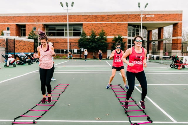 Stephanie Arnold, Ashely Trapp and Sarah Talone participate in one of the fitness drills at Austin Peay State University as members of Stroller Strong Moms.