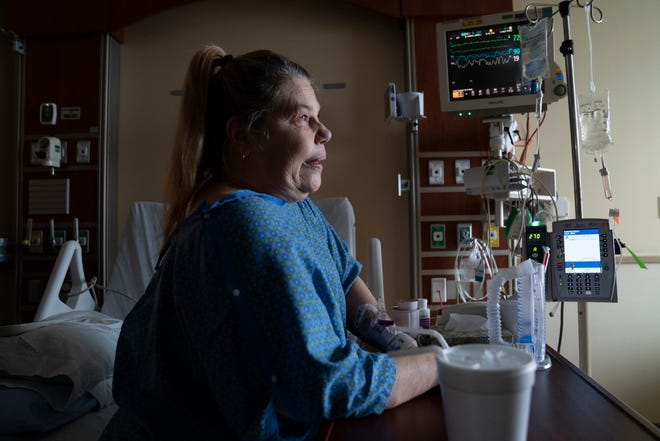 Andrea Kanerva, 59, of Hamburg Township still regulates her breathing as she speaks to a reporter from her bed in the COVID-19 unit at St. Joseph Mercy Hospital in Ypsilanti on Tuesday, April 20, 2021. Kanerva was waiting for release from the hospital.