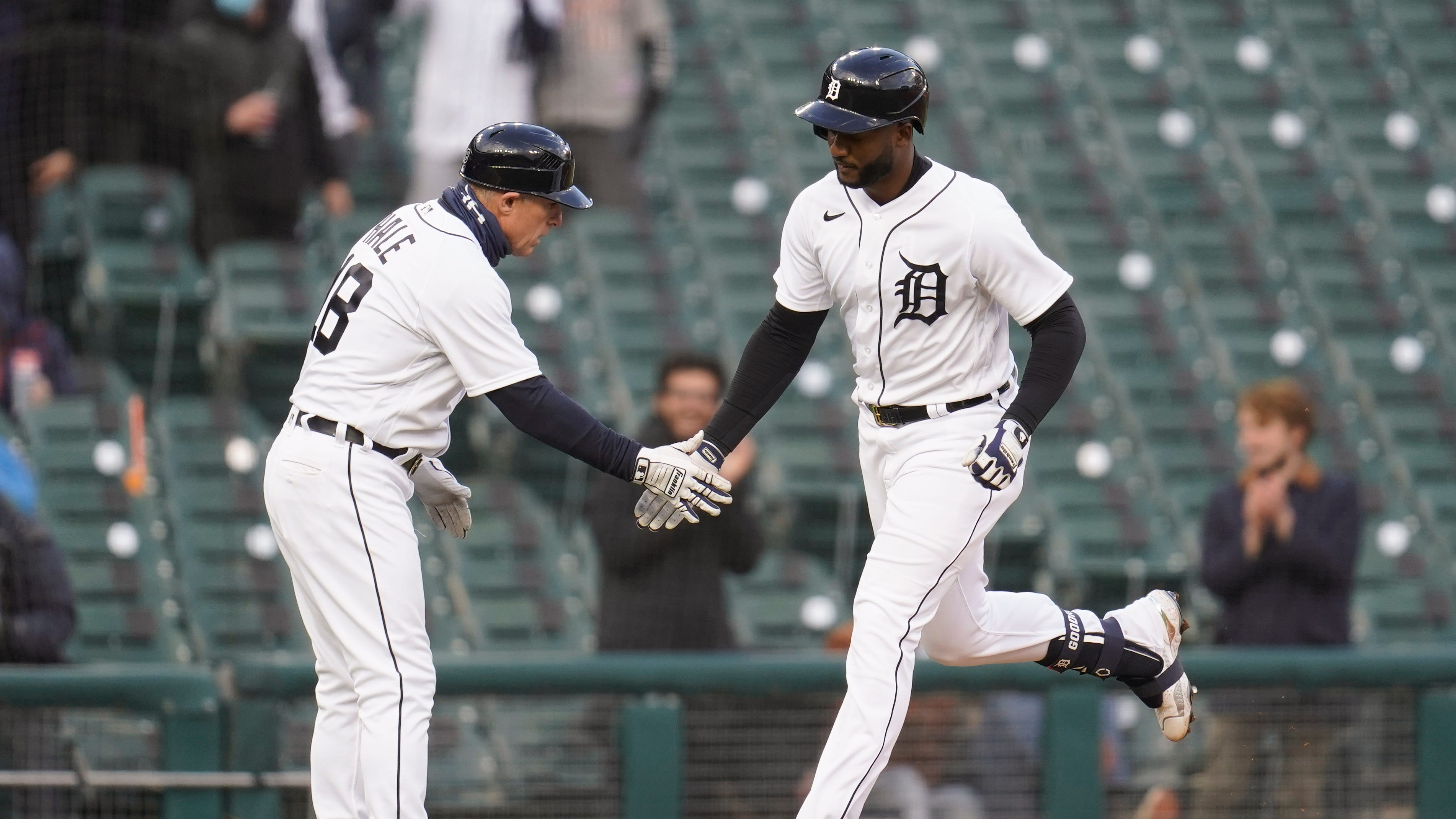Detroit Tigers' Niko Goodrum celebrates his solo home run with third base coach Chip Hale (18) in the third inning against the Pittsburgh Pirates during the second game of a doubleheader baseball game in Detroit, Wednesday, April 21, 2021.