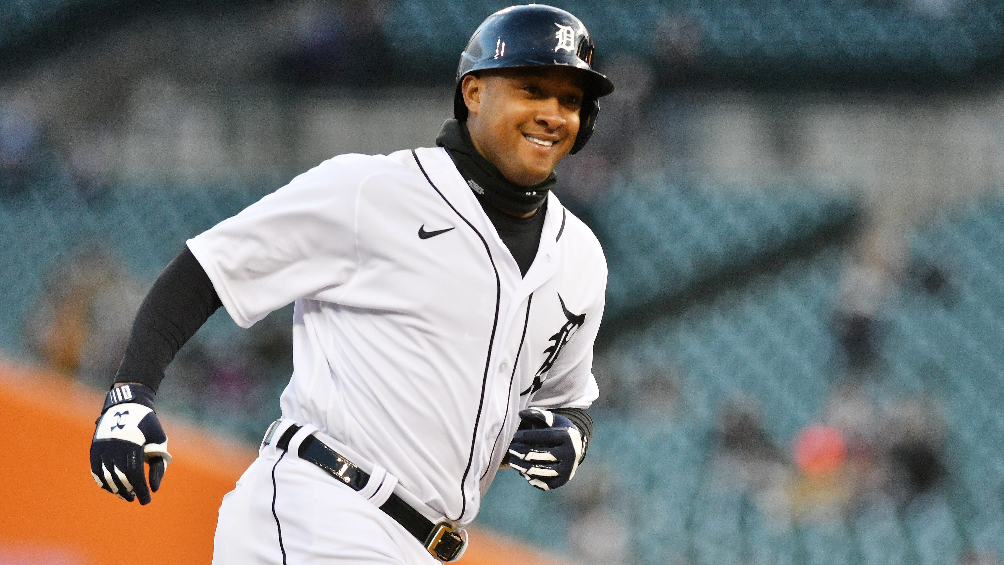 Tigers' Jonathan Schoop smiles rounding the bases on his solo home run in the fifth inning.
