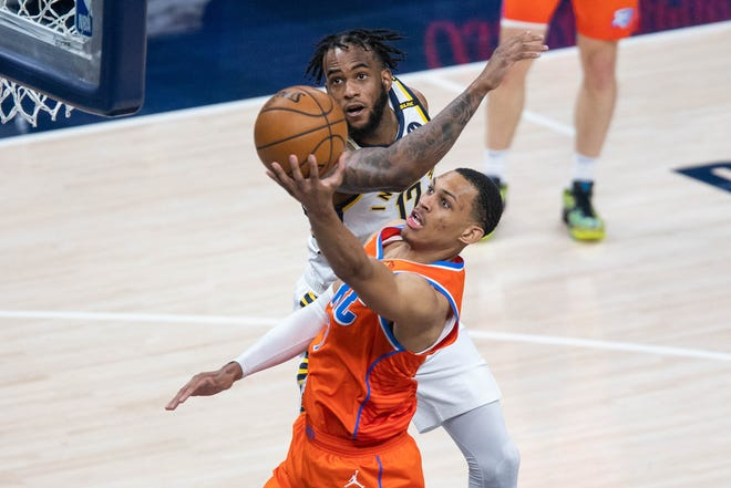 Apr 21, 2021; Indianapolis, Indiana, USA; Oklahoma City Thunder forward Darius Bazley (7) shoots the ball against Indiana Pacers forward Oshae Brissett (12)  in the third quarter at Bankers Life Fieldhouse.