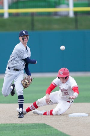 Central Catholic's Mark Cramer (10) throws to first as West Lafayette's Nate Brown (11) overshoots second base during the fourth inning of an IHSAA baseball game, Wednesday, April 21, 2021 in Lafayette.