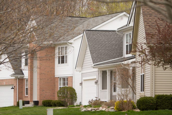 Property values for homes like these homes shown on Stillriver Drive in Genoa Township Thursday, April 22, 2021 have been rising, but tax bills won't show much change.