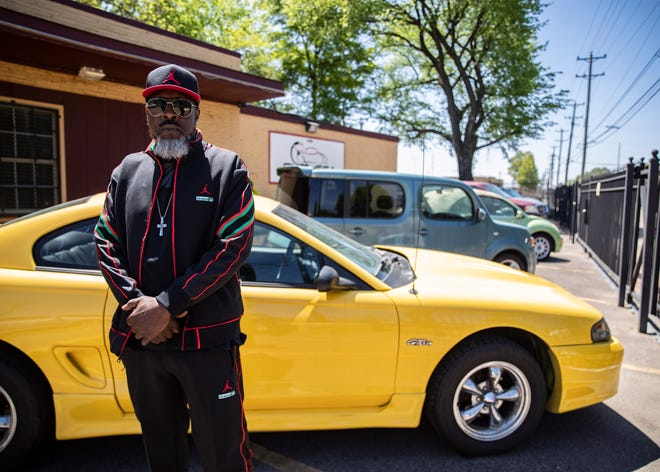 Marvin Coleman stands in his car lot ,Chelsea Auto Mart on Wednesday, April 22, 2021  in Memphis, Tenn. Coleman is formerly incarcerated individual who became a business owner in the Hyde Park area.
