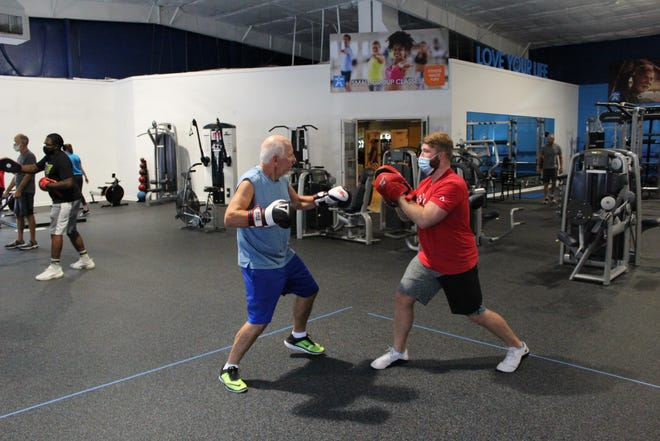 Lee Accavallo, 67, left, of Estero, boxes with Michael Compton at FYZICAL Therapy & Balance Center, in this photo at the one along Metro Parkway in Fort Myers. The centers offer Rock Steady Boxing group classes designed by medical professionals to alleviate some symptoms impacting the lives of those living with Parkinson's.