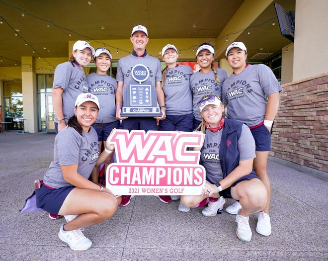 The New Mexico State women's golf team poses for a photo after winning the Western Athletic Conference championship on Wednesday, April 21, 2021, at Boulder Creek Golf Club in Boulder City, Nevada.
