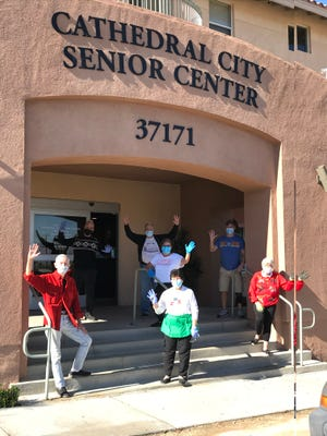 Food bank and lunch volunteers at the Cathedral City Senior Center congregate for a group shot.