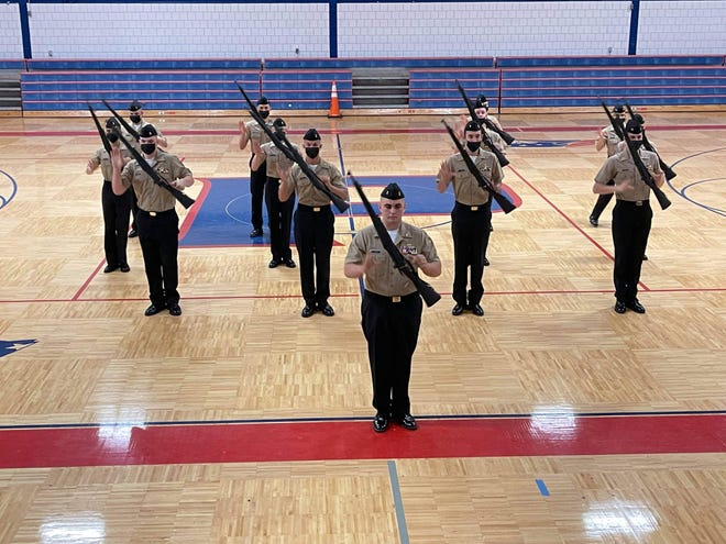 Members of Pace High Schools JROTC drill team compete in an armed exhibition during this year's Navy Nationals Academic, Athletic and Drill Competition. The team won first overall.