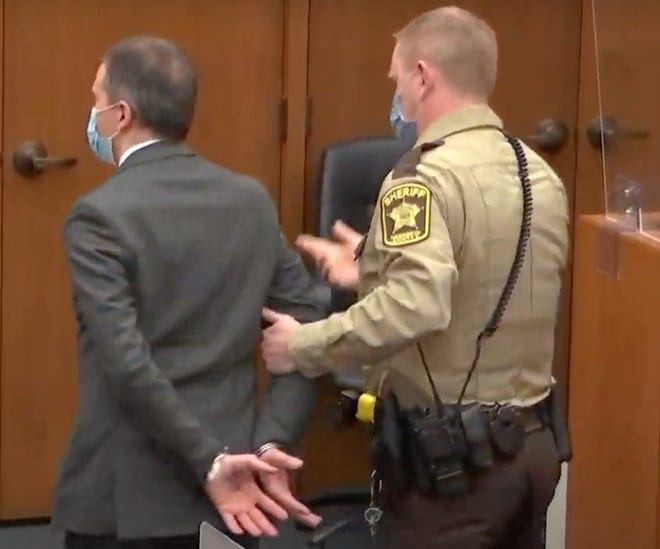 Derek Chauvin is placed in custody after his guilty verdict on all charges in an image from Court TV,  is read on Tuesday, April 20, 2021, in the trial of Chauvin, in the May 25, 2020, death of George Floyd at the Hennepin County Courthouse in Minneapolis, Minn. (Court TV/Pool/TNS)