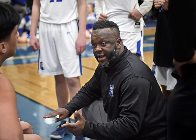 McQueen high basketball coach Keith Crawford talks to his players during a timeout against Damonte Ranch on Jan. 7, 2020.