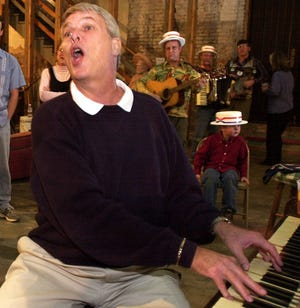 """Springfield's Gary Ellison, shown here performing at a 2002 Commercial Street wake for a local musician, was named """"Missouri's Official Ragtime Piano Player"""" by the state senate in 1973. He will perform Scott Joplin hits and other ragtime music in a Springfield Symphony concert celebrating Missouri's 200th birthday on May 8, 2021."""