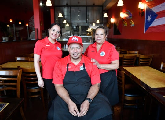 Left to right, Sheila Rodriguez, Carlos Pabon and Evelyn Rodriguez pose for a photo at El Tuque Restaurant in Vineland, N.J. Pabon's Landis Avenue establishment specializes in Puerto Rican cuisine. April 22, 2021.
