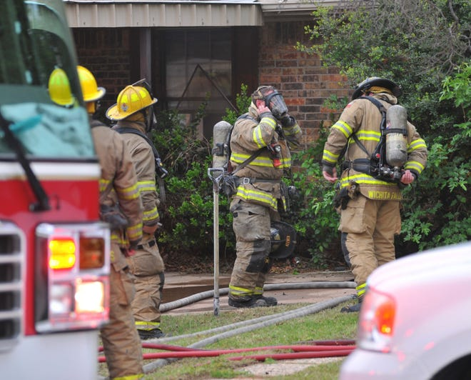 Wichita Falls Firefighters work the scene of a structure fire Wednesday evening at a home on McGaha.