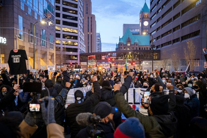 Residents of Minneapolis march during jury deliberations in the trial of former Officer Derek Chauvin on Apr 19, 2021. Chauvin is charged with second-degree murder, third-degree murder and second-degree manslaughter in the death of George Floyd. Floyd died on May 25, 2020 while in police custody. A video showing Derek Chauvin kneeling on George Floyd's neck sparked world wide protests against police brutality.