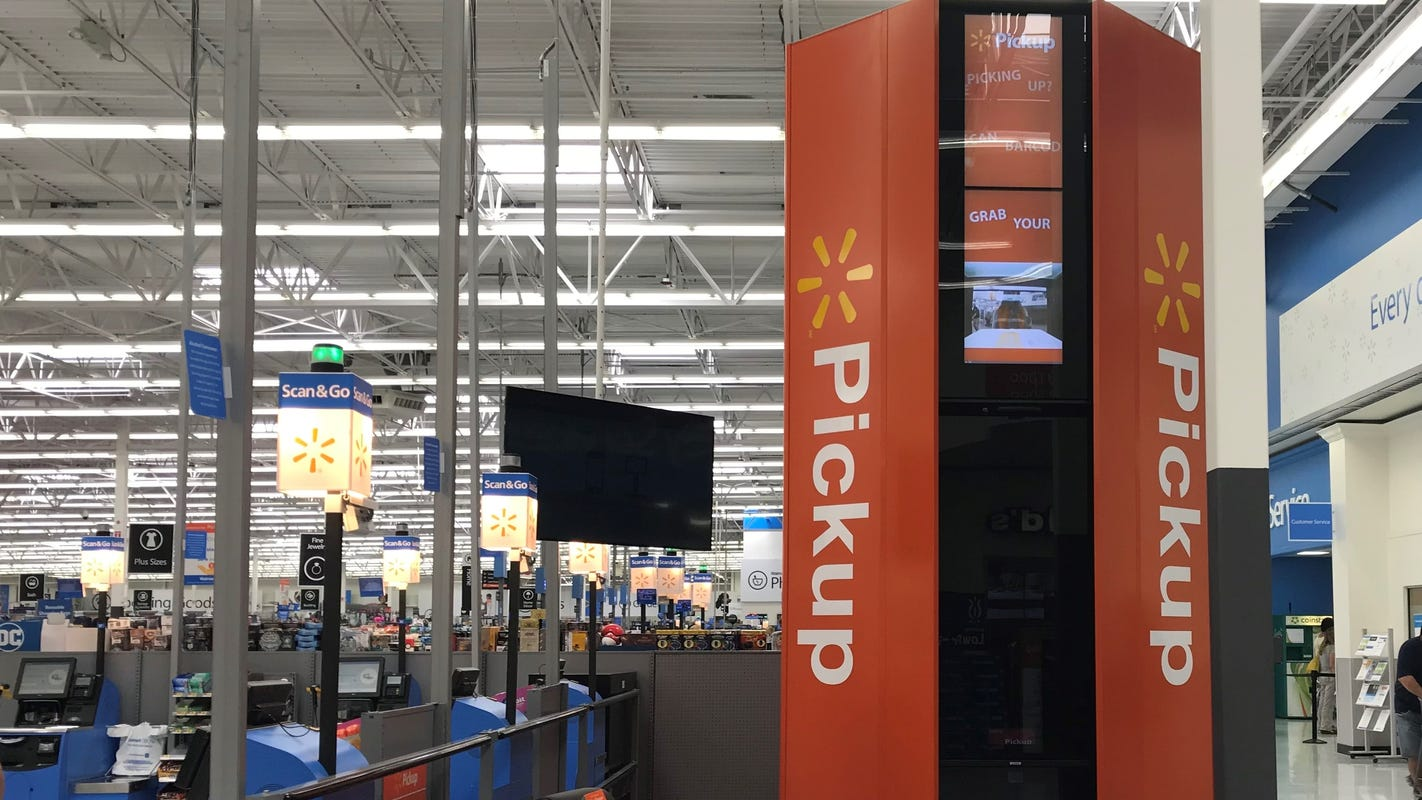 Walmart moves more online orders to curbside as it phases out pickup towers