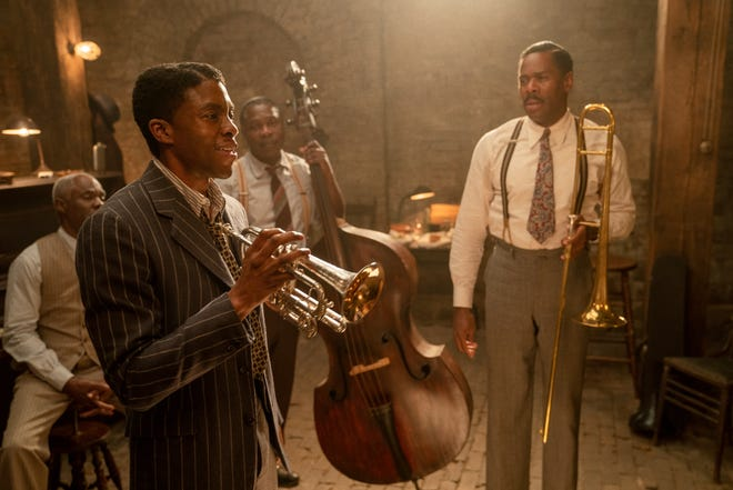 """Levee (Chadwick Boseman, front left) has designs on a solo music career and lets his bandmates (Glynn Turman, Michael Potts and Colman Domingo) know in """"Ma Rainey's Black Bottom."""""""