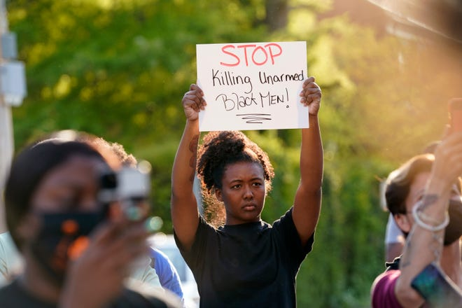 People gather outside the municipal building in Elizabeth City, N.C., after Andrew Brown Jr. was fatally shot by Pasquotank County sheriff's deputies executing a search warrant on April 21. The sheriff has not released the body camera video.