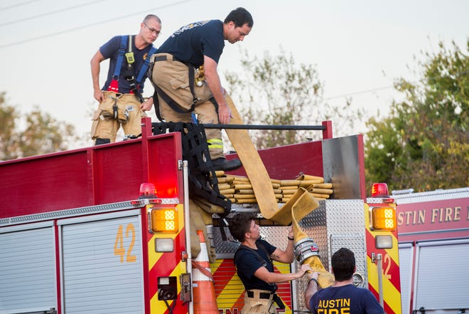Austin firefighters respond to a structure fire on Blue Bluff Road last year. Proposition A on Saturday's ballot involves the negotiation process between the firefighters' union andthe city, allowing either sideto demand binding arbitration if contract talks reach an impasse.