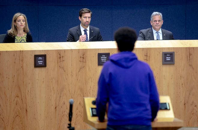 From left, City Council Member Kathie Tovo, City Manager Spencer Cronk and Mayor Steve Adler listen to public comments during a council meeting in 2018. Austin voters are deciding whether to keep the council-manager form of government or switch to a strong mayor format.
